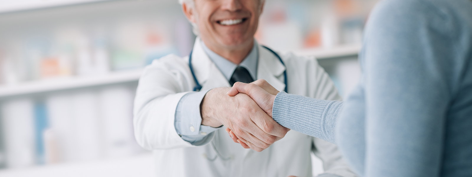 Male veterinarian shaking hands with a woman