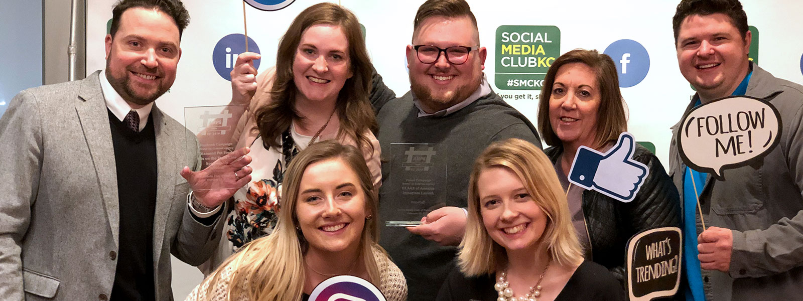 Woodruff Employees Posing with AMPS Awards Plaques | Woodruff
