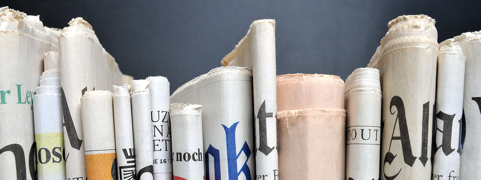 Various Newspapers Folded and Stacked | Woodruff