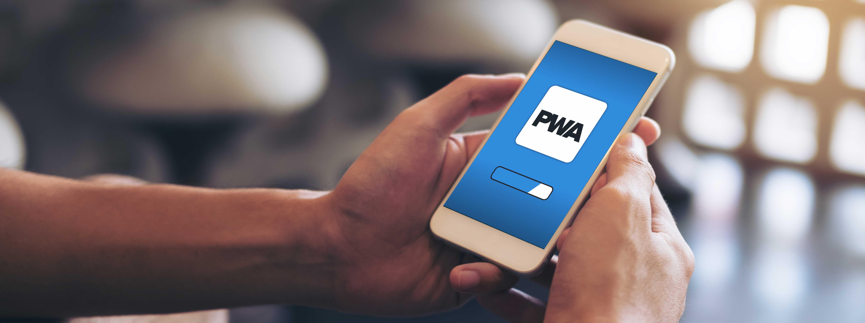 Person Holding a Smartphone, Loading a Progressive Web App | Woodruff