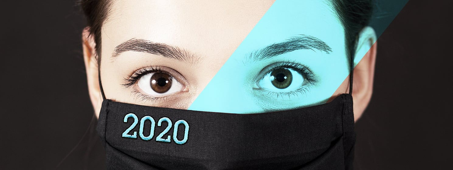 Close -Up of Woman Wearing a Face Mask with 2020 Embroidered on It   Woodruff