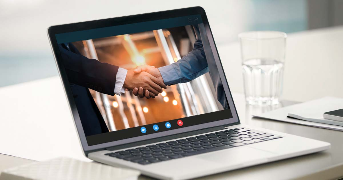 A Laptop Displaying a Handshake on a Telecall | Woodruff